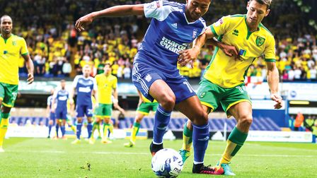 Grant Ward battles with Wesley Hoolahan during the Ipswich Town v Norwich City (Championship) match