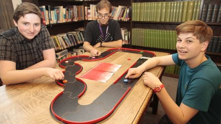 Left to right: Myles Miller, Chris Filip and Alex Mann, during board games at the Fun Palace event a