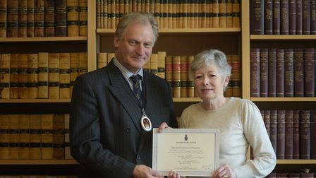 Witness Service volunteer Sue Godfrey receives her certificate from the High Sheriff of Suffolk, Geo