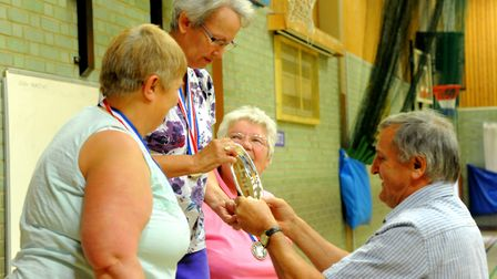 Competitors in the first ActivLives Community Games for over 50s collect the medals and trophies in