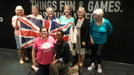 The group wave their Union Jack flag with pride on their trip to New Orleans. Picture: JANE TUOHEY