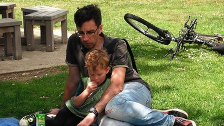 Parents reading to children helps encourage them to become readers themselves. Picture: SUFFOLK LIBR