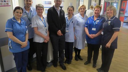 Ian Cutting and staff from the ward where the photos have been hung. Pictures: Ipswich Hospital