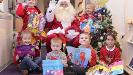 Children at Hillside Primary School in Ipswich received a book from Father Christmas. Pictured: Neal