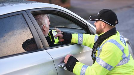 A driver takes a police breathalyser test on Woodbridge Road. Picture: GREGG BROWN