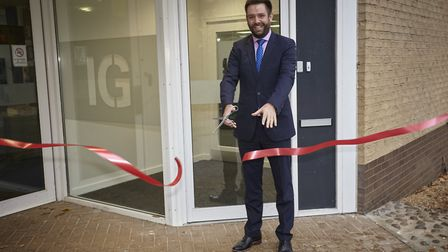 IG Group managing director Matt Ellis cutting the ribbon to mark the official opening of the company