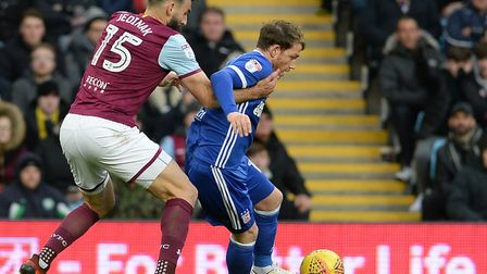 Town's Joe Garner tries to keep the ball away from Mile Jedinak, at Villa Park. Picture Pagepix