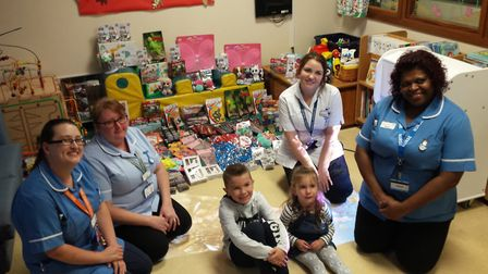 Bobby Lankester with sister Grace and Ipswich Hospital staff. Picture: LOUISE LANKESTER