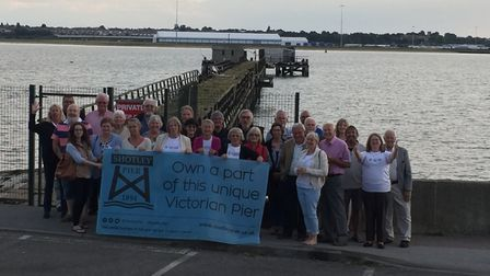 Volunteers and investors celebrating reaching £120,000 raised for the retsoration of Shotley pier. P