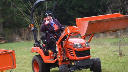Michela Morton gives thumbs up to the new tractor. Picture: GREGG BROWN