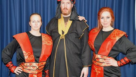 Abanazar Rob Dack and his sidekicks Lo (Emma Cole) and Hi (Bex Nicholls). The Orchard Players are st