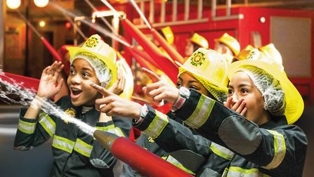 Tackling a fire at KidZania, The would-be firefighters travel in a converted golf buggy