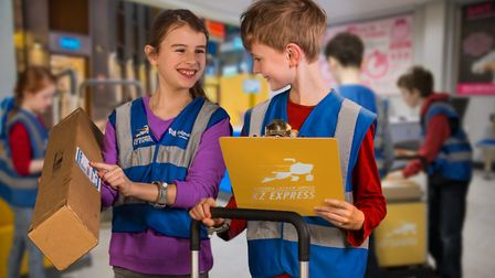 Kids can become couriers at KidZania and deliver post to earn their wages