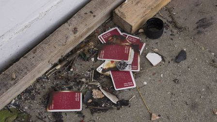 Discarded playing cards at Broomhill Swimming Pool in Ipswich. Picture: DEBORAH NORWOOD PHOTOGRAPHY