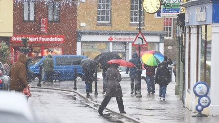 Sudbury shoppers brave the snowy conditions. Picture: GREGG BROWN