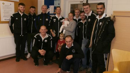 Trimley Athletic team-mates with Dave White and family after the trophy presentation on Saturday. Pi
