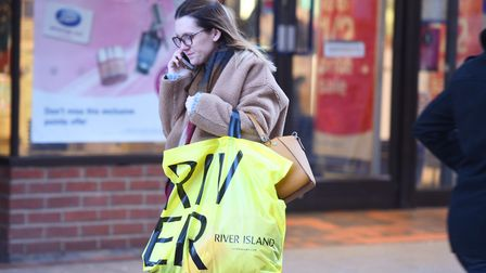 A shopper walks down Tavern Street in Ipswich on Boxing Day morning. Picture: GREGG BROWN