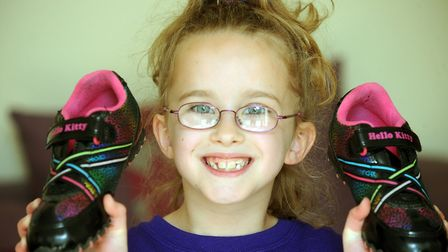 Isobelle pictured with the shoes she used for a charity walk to raise money for the organisations th