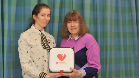 Kim and Jill Hickey with the new defibrillator purchased in Chris Hickey's memory. Picture: SARAH L