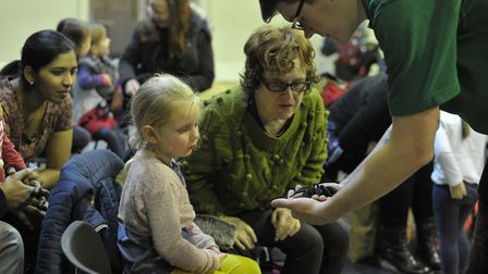 A tarantula is shown to intrigued visitors. Picture: SARAH LUCY BROWN