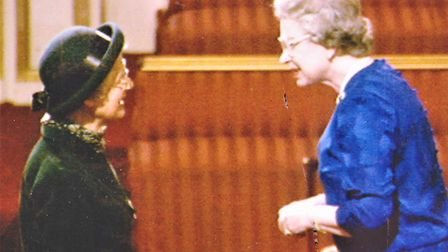 Jill Cross receiving her MBE from The Queen in 1993. Picture: PIPPA CROSS