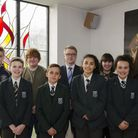 Matt Baker, the new headteacher at St Alban's Catholic High School in Ipswich, with students at the