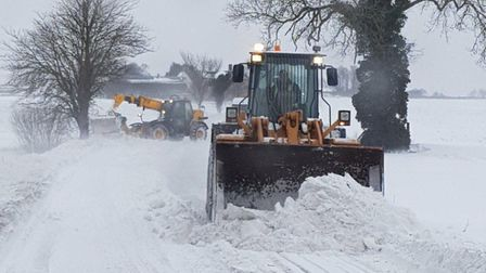 Staff at Gibbons Plant Hire, in Crowfield, used their machines to help clear snow from the A140. Pic
