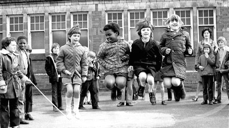 Skipping being played with a very large rope in the playground at Clifford Road School in 1974. Pict