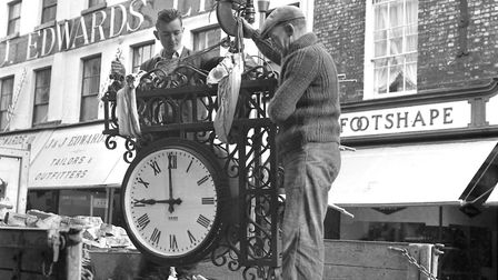 Workmen prepare Croydon's clock for lifting back into position in May 1966. Tavern Street shops, in