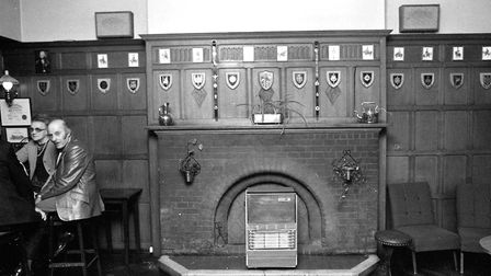 The fireplace area in the Royal George was once adorned with decorative crests - do you know if they