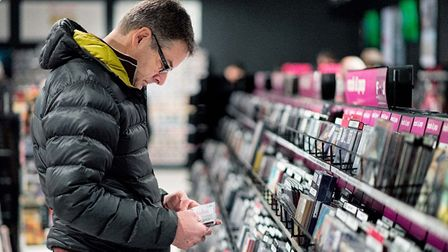 A shopper browsing through albums at the newly opened HMV store in Sailmakers shopping centre. Pictu
