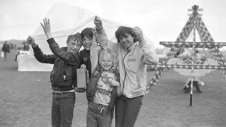 Some youngsters take shelter from the rain at the Gainsborough gala day in 1984. Picture: PAUL NIXON