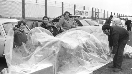 A group guards something from the elements - but do you know what it is beneath the cover? Picture: