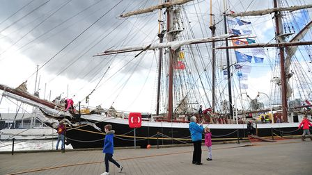 Passers by admire the tall ships that have arrived on the waterfront. Picture: SARAH LUCY BROWN