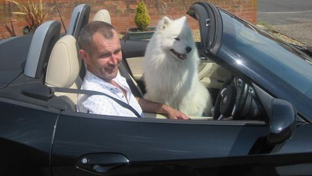 John Hawkes in his car with Tycho the dog. Picture: SUPPLIED BY THE HAWKES FAMILY