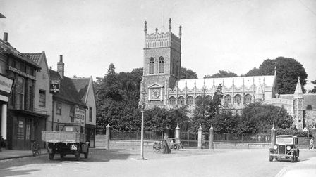 St Margaret's Green and church in the 1930s. The Saracens Head public house on the left, at the corn