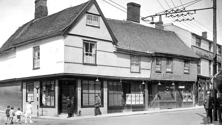 Fore Street, Ipswich, at the junction with Salthouse Street (left), around 1935. The premises of J