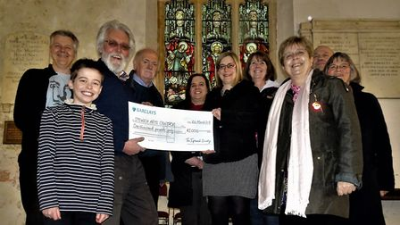 John Norman presenting the cheque to Sarah Shepperd and Carol Gant with members of the Ipswich Arts