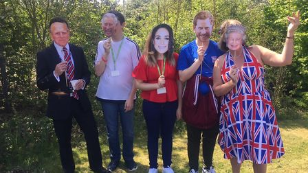 Teachers and students at Suffolk One wore their royal family masks for the garden party Picture: JOH