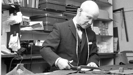 A tailor at work in the Grimwades shop in Ipswich in November 1963. Do you know who he was? Picture: