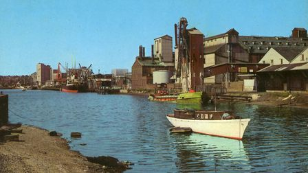 An undated photograph from around 1970 of Ipswich Dock from near the lock gates. A ship loaded with