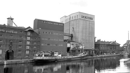 A 1960s photograph of Albion Wharf and Common Quay at Ipswich dock. The R and W Paul building on the