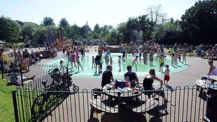 Families enjoy the water in Hoywells Park. Picture: PHIL MORLEY