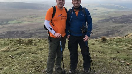 Kieran and Mark Wilding at the top of Pen-y-Ghent during the Yorkshire Three Peaks Challenge Picture