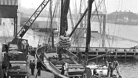 The last working sailing barge at Ipswich Dock, the Cambria, being loaded at the quay near Coprolite