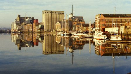 Reflecting on the past. A 1970s photograph of quays at Ipswich Dock from Neptune Quay. Picture: DAVI