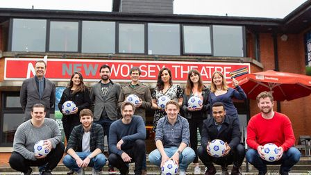 The cast of Our Blue Heaven, the New Wolsey's new musical, celebrating Ipswich Town's FA Cup win in