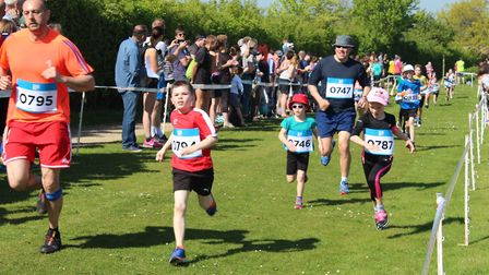 Youngsters eye the finish line during the Alton Water Run. Picture: ROSEMARY BUTLER