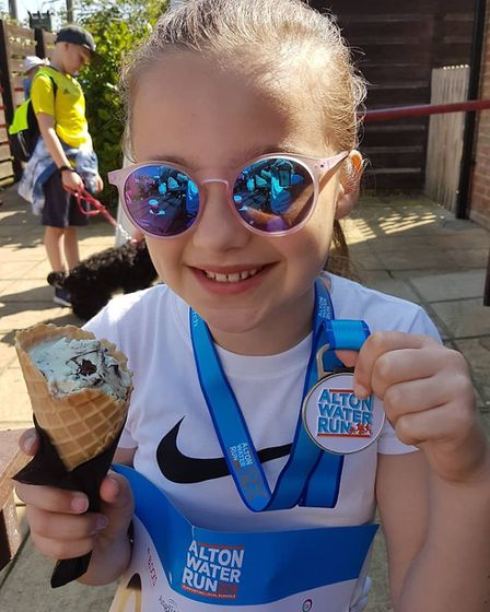 A young runner enjoys a well-deserved treat after finishing the Alton Water Run. Picture: ANITA BOND