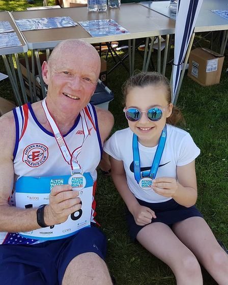 Runners show off their medals after completing the Alton Water Run. Picture: ANITA BOND
